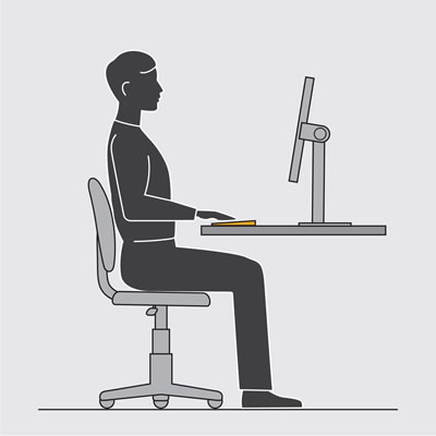 Illustration showing a person seated at a desk working on a keyboard placed near the front edge of the desk.
